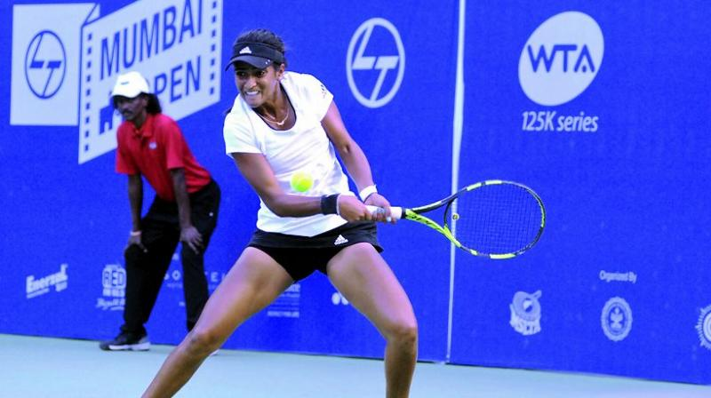 Rutuja Bhosale hits a shot during her match at the Mumbai Open at the CCI courts on Tuesday.