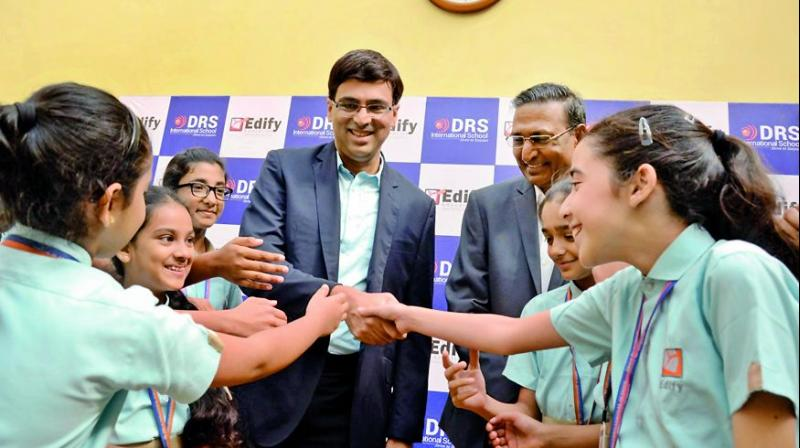 Former world chess champion Viswanathan Anand greets schoolkids at an event in Hyderabad (Photo: DC)
