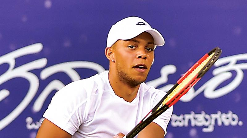 Briton Jay Clarke plays a return in his victory over Ramkumar Ramanathan at the KSLTA courts in Bengaluru on Wednesday. (Photo: SHASHIDHAR B)