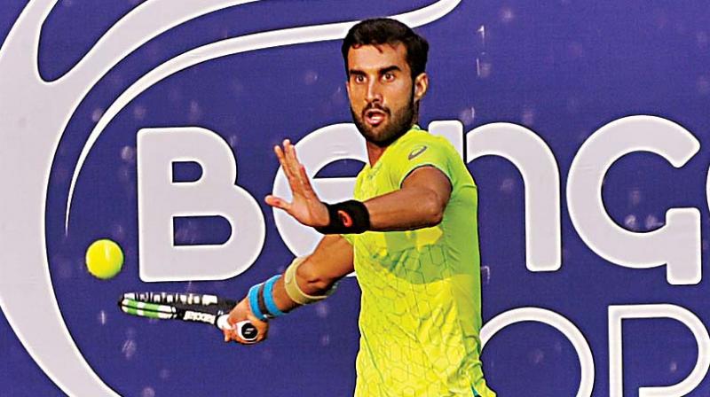 Yuki Bhambri plays a return in his quarter-final victory over Prajnesh Gunneswaran at the KSLTA courts in Bengaluru on Thursday (Photo: SHASHIDHAR B.)