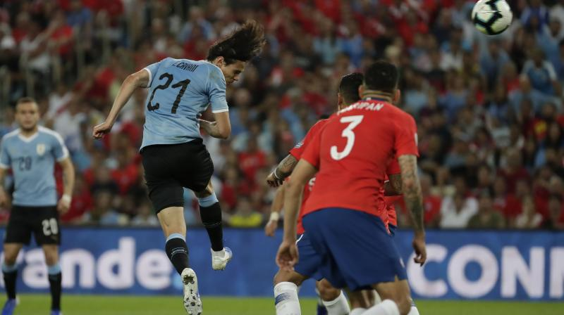 A late header from Edinson Cavani gave Uruguay a 1-0 win over Copa America holders Chile on Monday which saw them snatch top spot in Group C at their opponents' expense and set up a quarter-final meeting with Peru. (Photo: AP)