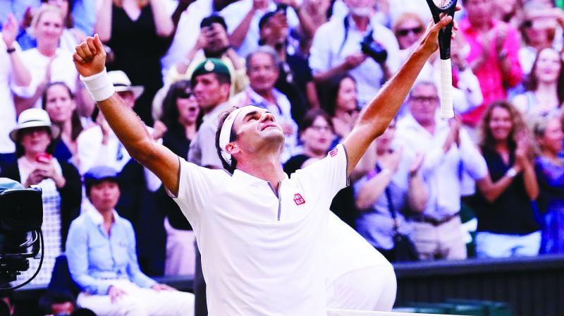 Roger Federer of Switzerland celebrates after beating Rafael Nadal of Spain in their men's singles semifinal at Wimbledon in London on Friday.(Photo: AP)