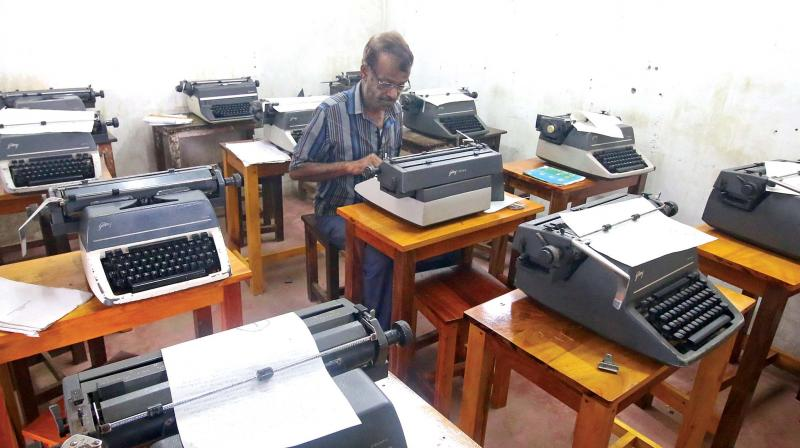 K.T. Soumyendran is busy repairing typewriters at Shikhi Typewriting institute, Kozhikode. (Photo: DC)