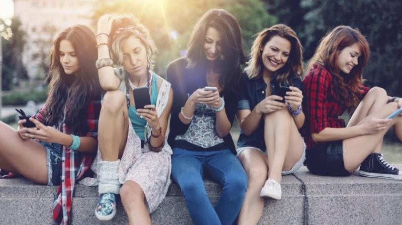 Social media usage on an average went up from an hour to two hours a day in a decade (Photo: AFP)
