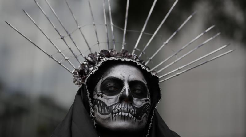 Mexicans parade through their capital dressed as skeletons in the run up to the Day of the Dead. The multi-day holiday focuses on gatherings of family and friends to pray for and remember friends and family members who have died, and help support their spiritual journey. In 2008, the tradition was inscribed in the Representative List of the Intangible Cultural Heritage of Humanity by UNESCO. (Photo: AP/ AFP)