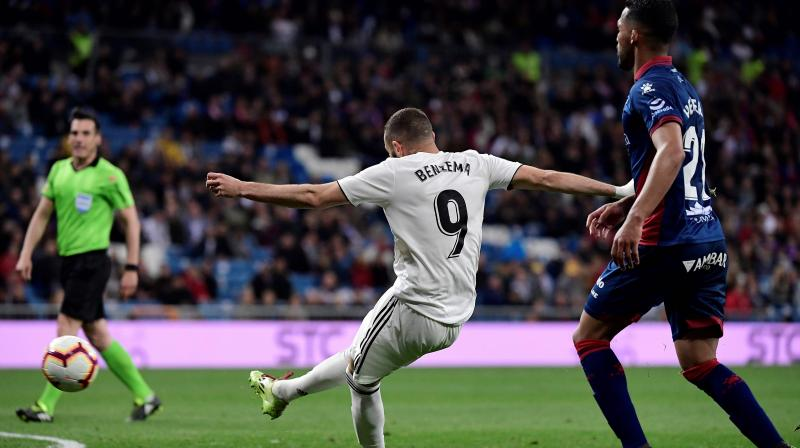 Benzema was on hand to break Huesca hearts with his 14th league goal of the season, which gives Zidane two wins from his first two matches back in charge. (Photo: AFP)