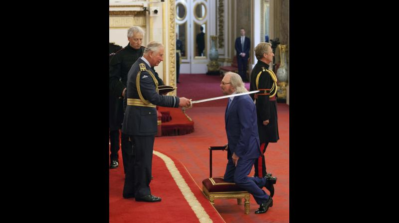 Singer and songwriter Barry Gibb is knighted by Britain's Prince Charles, during an Investiture ceremony at Buckingham Palace in London, Tuesday June 26, 2018. (Photo: AP)
