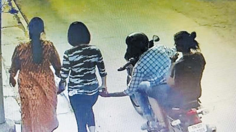CCTV grab of couple snatching the mobile phone.  (Photo: DC)