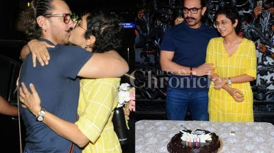 Checkout photos of Aamir Khan posing with his wife Kiran Rao, while celebrating his birthday with the media in Mumbai. (Pictures: Viral Bhayani)