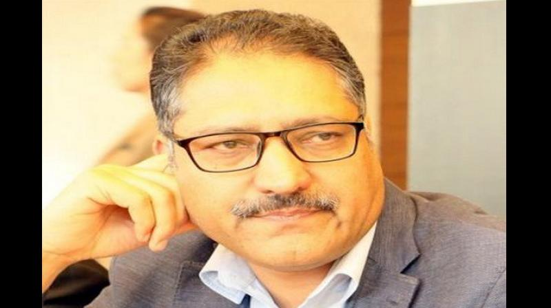 Shujaat Bukhari, who was in his 50s, was the editor and owner of 'Rising Kashmir' (English) and 'Buland Kashmir' (Urdu). (Photo: twitter | @bukharishujaat)