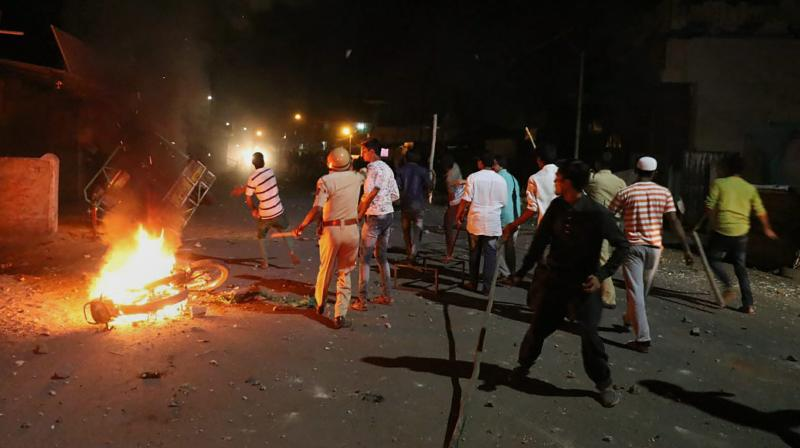 Rioters hurl stones and sticks during a communal riot that escalated due to clamping illegal water connection in a religious place in Moti Karanja area of Aurangabad on Friday night. (Photo: PTI)
