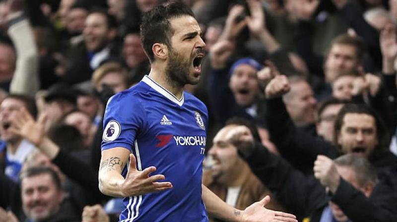 Cesc Fabregas made sure Chelsea capitalised on Tottenham Hotspur's 1-0 defeat at West Ham United on Friday by setting up goals for Diego Costa and Nemanja Matic. (Photo: AP)