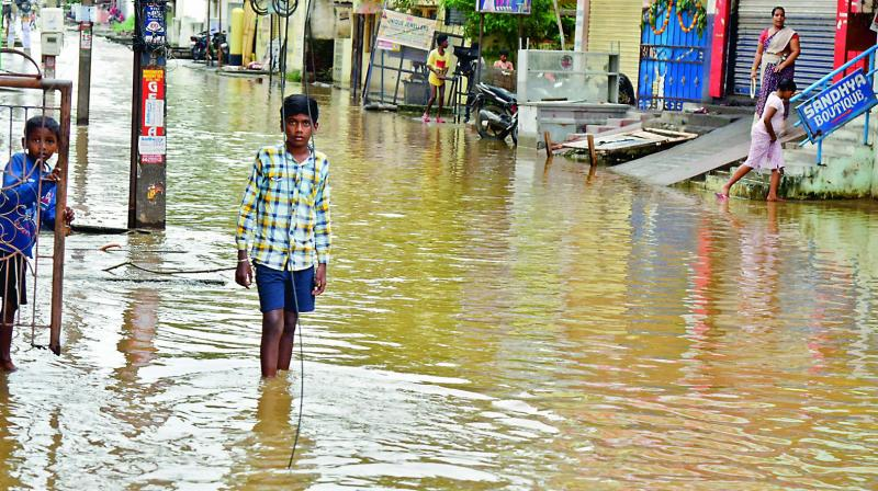 Floodwater entered the ground floors of several shops and houses in Alwal on Saturday. (Photo: S. Surender Reddy)