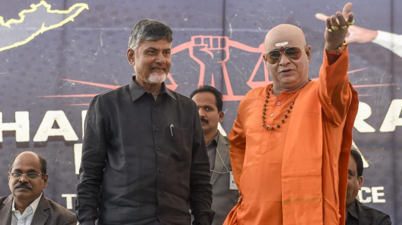 Chief Minister Chandrababu Naidu, left, and a NTR lookalike during Dharma Porata Deeksha, a day-long fast to demand special status for the state of Andhra Pradesh, in New Delhi, Monday. (Photo: AP)