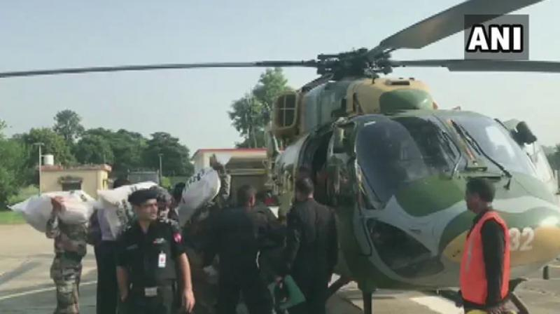 Officials said airdropping of food packets will continue in the marooned villages with the help of the Army till the situation normalises. (Photo: ANI)