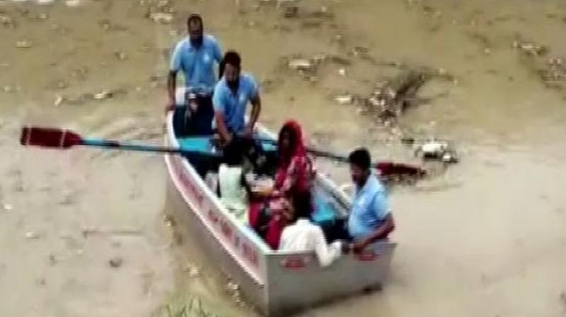The water level swells following the release of 1.43 lakh cusec water from Haryana. (Photo: ANI)