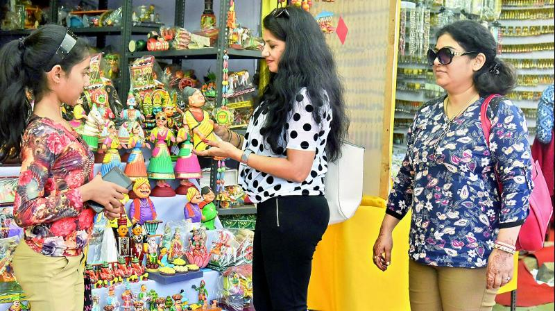 Shoppers look at handicraft toys at a stall at Shilparamam in Hyderabad on Monday. (Photo: DC)