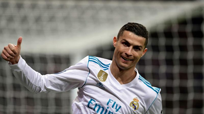 Cristiano Ronaldo became the first player to score in all six Champions League group-stage matches in a season while also equalling his Barcelona rival Lionel Messi's record of 60 group-stage goals in total. (Photo: AFP)