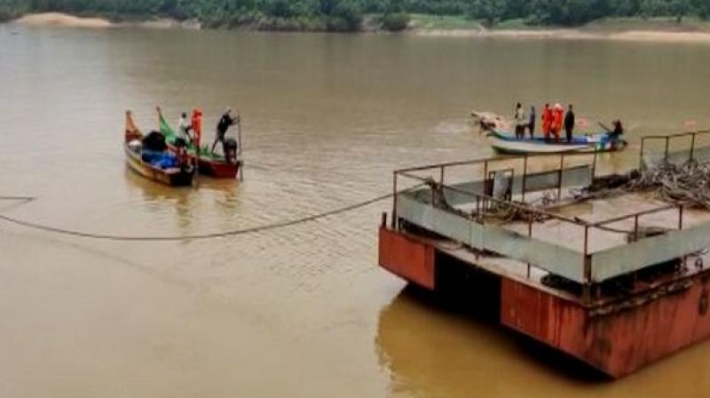 The boat capsized on September 15 in Godavari River near Katchuluru village in a dense forest area situated in the East Godavari district. (Photo: ANI)