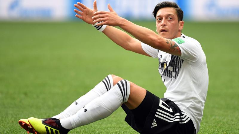 Mesut Ozil was heavily criticised after he, along with his teammate, Ilkay Gundogan, who has Turkish ancestry, posed for a photograph with Erdogan at a charitable event in May. (Photo: AFP)