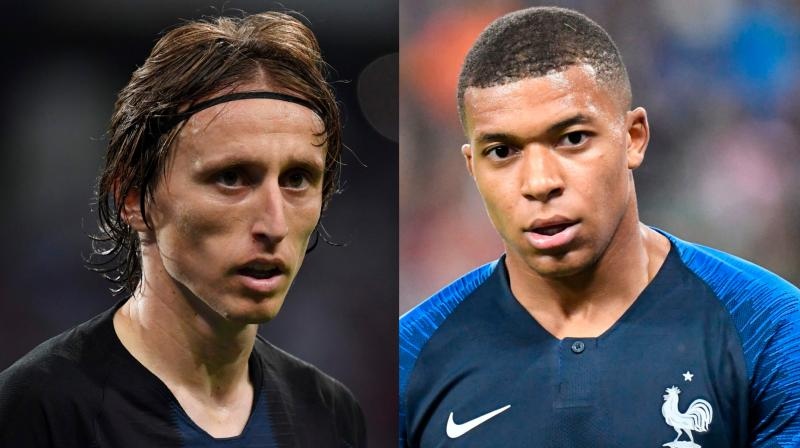 World Cup stars Kylian Mbappe and Luka Modric will challenge the decade-long dominance of FIFA's best player award by Cristiano Ronaldo and Lionel Messi. (Photo: AFP)