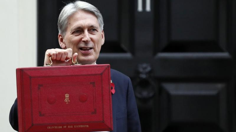 Britain's Chancellor of the Exchequer Philip Hammond holds up the traditional red dispatch box.