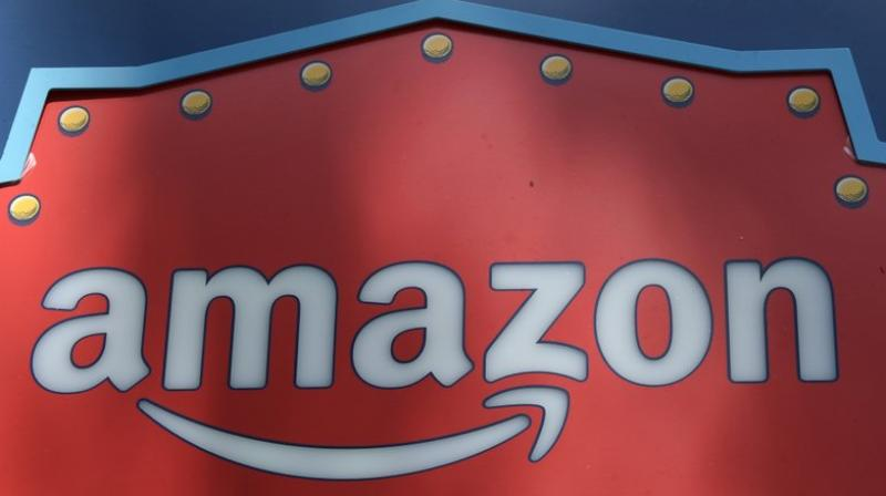 The 'Merch by Amazon' on-demand printing service, in its third full year of operation, works by printing t-shirts once an order comes in.. (AP Photo/Richard Vogel, File)