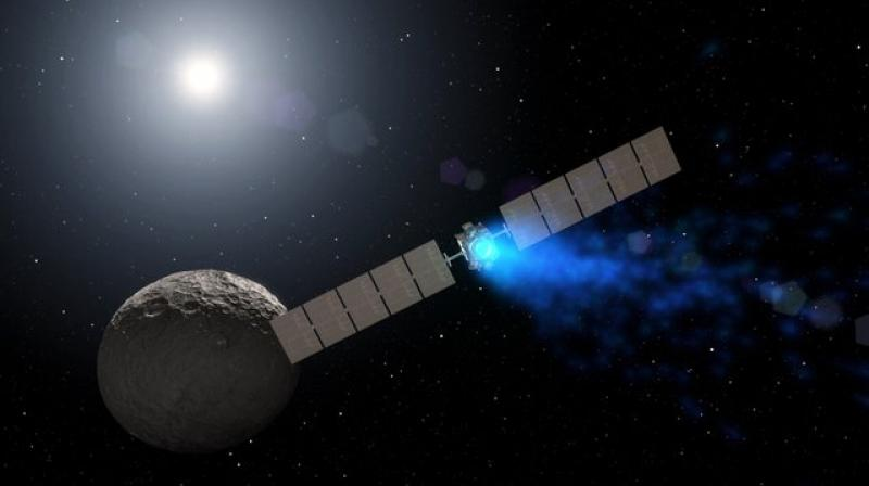 This illustration made available by NASA depicts the Dawn spacecraft orbiting the dwarf planet Ceres. On Thursday, Nov. 1, 2018, NASA announced it had lost the probe, ending a fruitful mission in the asteroid belt. (NASA via AP)