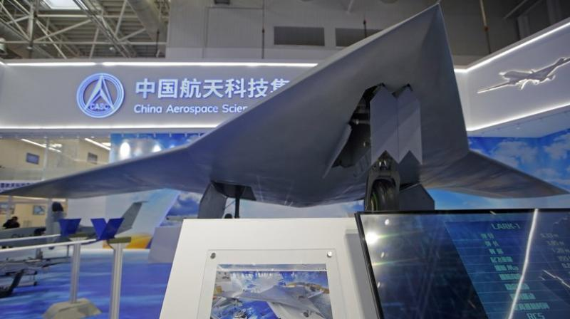 """The CH-7′s chief designer Shi Wen says the aircraft can """"fly long hours, scout and strike the target when necessary."""" (AP Photo/Kin Cheung)"""