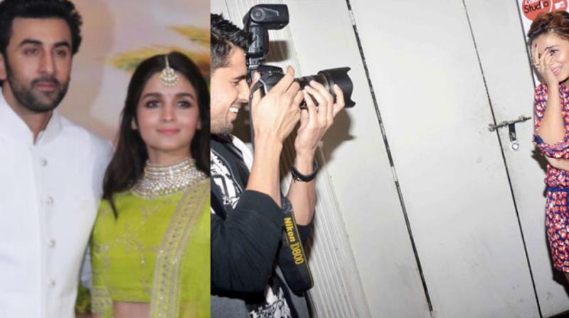 Ranbir Kapoor with Alia Bhatt, Sidharth Malhotra capturing Alia Bhatt.