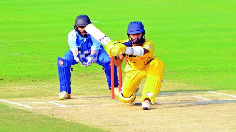 Tamil Nadu's Dinesh Karthik en route to his 28-ball 57 against Andhra at Visakhapatnam on Monday. (Photo: Murali Krishna)