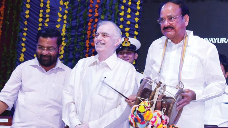 Vice-President M. Venkaiah Naidu plays Idakka which was presented to him during a function held in Guruvayur on Monday. Governor P. Sathasivam and Devaswom Minister Kadakampalli Surendran are also seen.