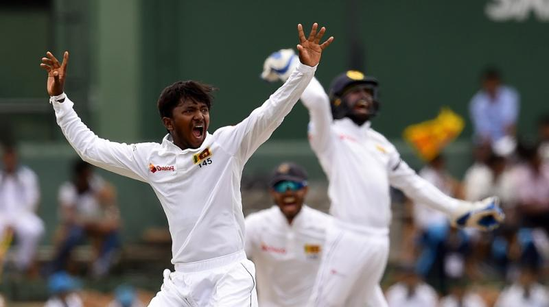 """""""(Akila) Dananjaya's bowling action will now be scrutinised further under the ICC process relating to suspected illegal bowling actions reported in Tests, ODIs and T20Is,"""" said ICC in a statement. (Photo: AFP)"""