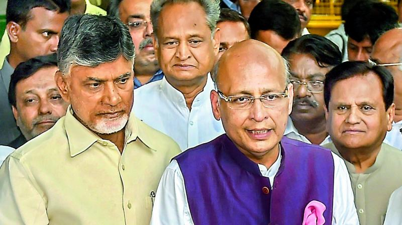 Opposition leader Abhishek Manu Singhvi talks to the mediapersons as AP CM N. Chandrababu Naidu, Ashok Gehlot and Ahmed Patel look on in New Delhi on Tuesday. (Photo: AP)