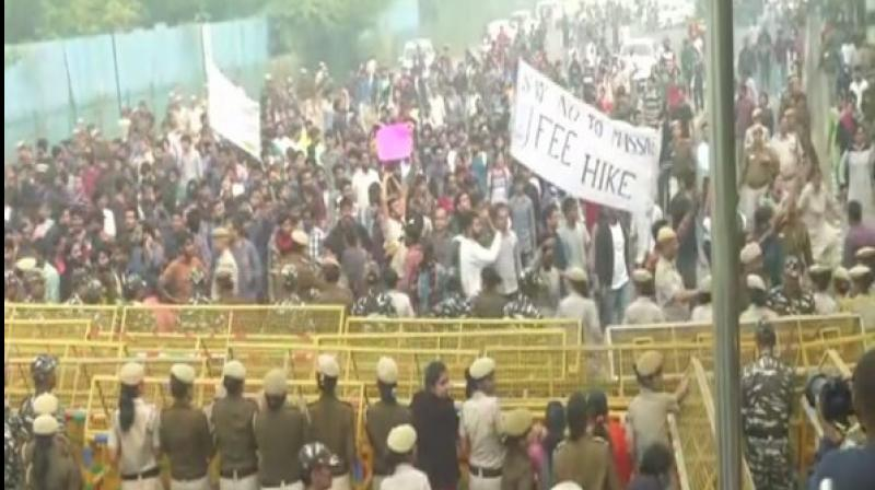 Hundreds of students staged protests outside the Jawaharlal Nehru University (JNU) on Monday over fee hike, curfew timings and dress code restrictions in the varsity. (Photo: ANI)