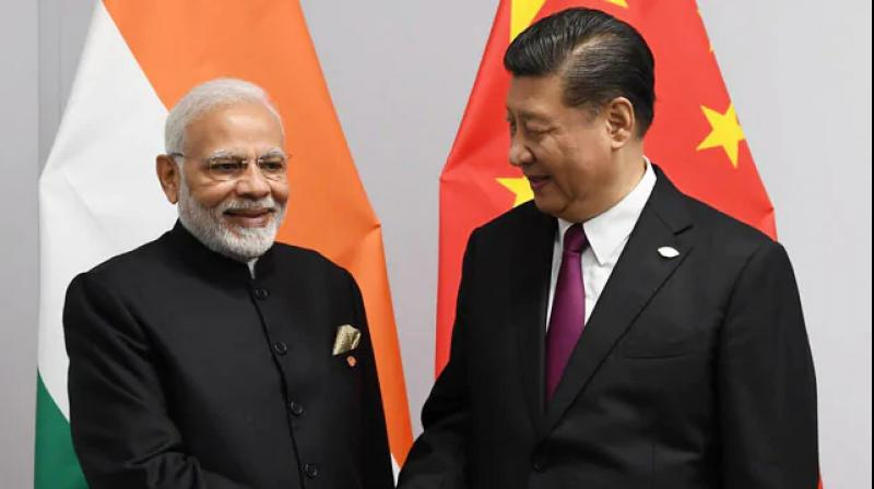 "Prime Minister Narendra Modi on Wednesday met Chinese President Xi Jinping and said there has been a ""new direction and new energy"" in bilateral ties after their second informal summit in Chennai as the two leaders discussed ways to further strengthen India-China relations, including on the trade front. (Photo: Twitter/ Narendra Modi)"