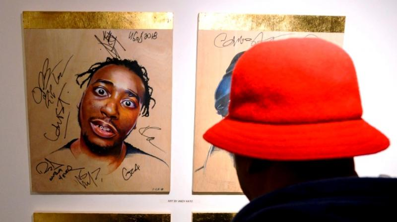 Grandmaster Caz looks at a portrait of late rapper Ol' Dirty Bastard of the Wu-Tang Clan at the hip-hop pop-up museum. (Photo: AFP)