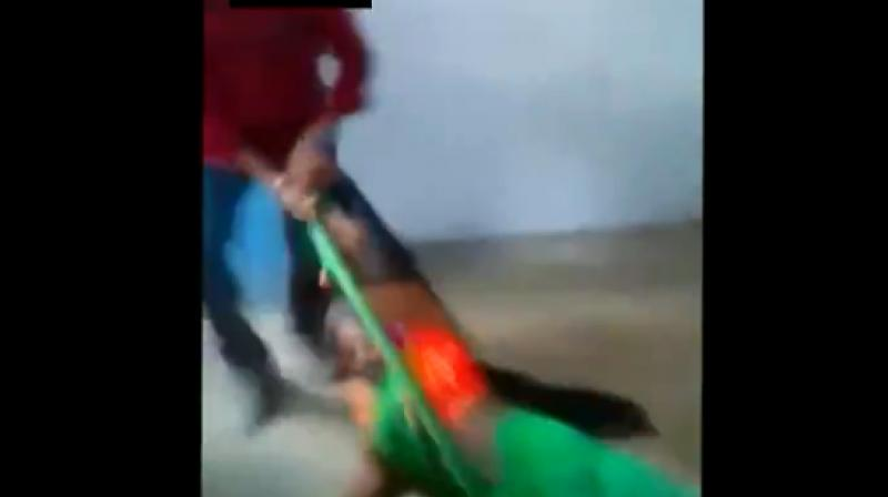 In the video, hostel superintendent Sumila Singh's husband Ranglal Singh pulled the woman by her hand from a bed after he asked her to leave the hostel.  (Photo: Screengrab)