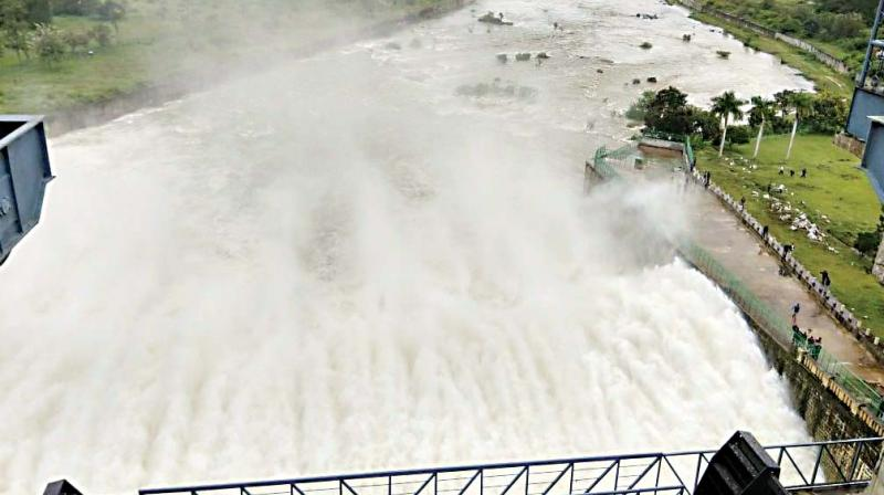 Water being released from Hemavathy Dam in Hassan on Saturday.