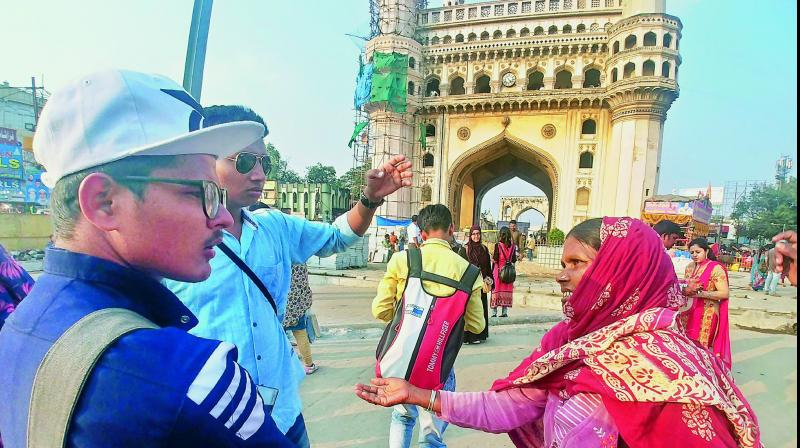 A woman begs from tourists near Charminar in Old City on Tuesday. (Photo: DC)