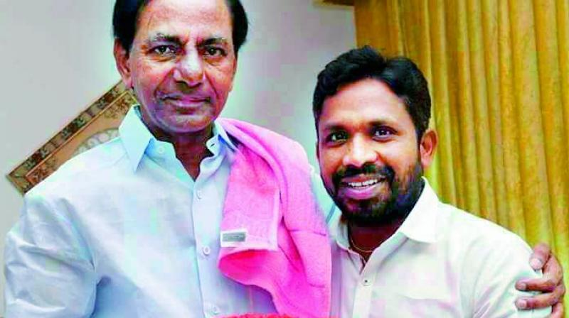 Chief Minister K. Chandrasekhar Rao with Errolla Srinivas, who was appointed to head the SC, ST commission. (Photo: DC)