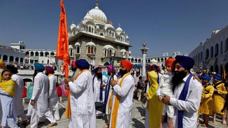 To mark the celebration of the formation of the Khalsa, the Sikhs visit gurdwaras on Baisakhi day. (Photo: AP)