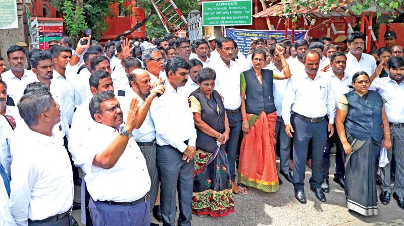 Lawyers protest outside the Madras high court on Tuesday. (Photo: DC)