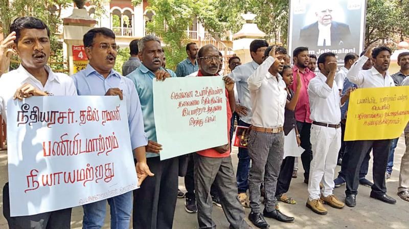 Lawyers protest in front of Coimbatore court complex.