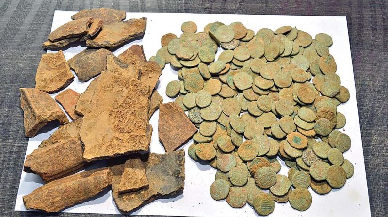 Local village administrative officer, who in turn rushed to the spot, collected all the copper coins and a broken pot.