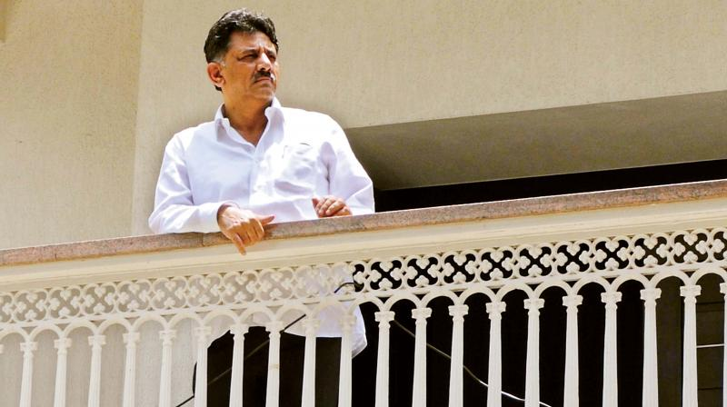 Minister D.K. Shivakumar waves to his fans during IT raids at his house in Sadashivanagar, Bengaluru, on Wednesday. (Photo: DC)