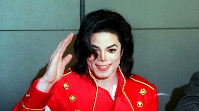 Michael Jackson, pictured at a news conference in 1996, faced major abuse allegations before his death. (Photo: AFP)