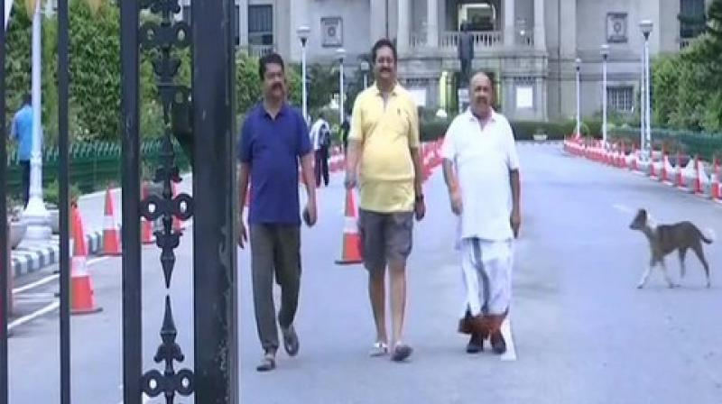 Some of the legislators, who were part of the unprecedented overnight 'dharna' at the Vidhana Soudha over their demand of floor test took a stroll around the assembly house after waking up early in the morning. (Photo: ANI)