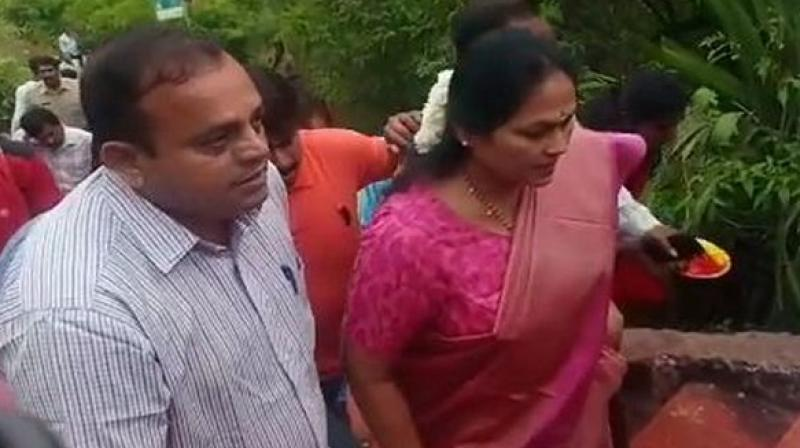 Draped in a traditional pink saree, the Bharatiya Janata Party MP from Udupi-Chickmaglur, along with BJP workers, climbed the ancient stone stairway barefoot to reach the 3,300 feet high summit of Chamundi hills which houses centuries-old Chamundeshwari temple. (Photo: ANI)