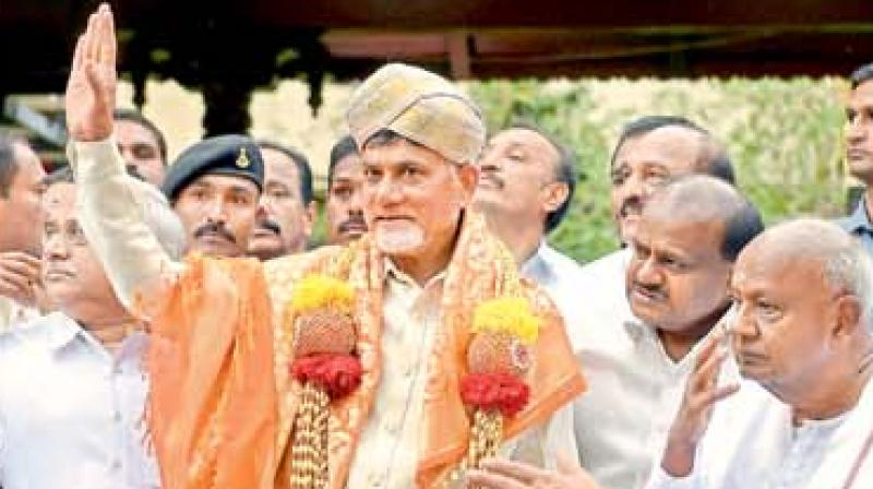 AP Chief Minister N. Chandrababu Naidu waves after being felicitated by Karnataka CM H.D. Kumaraswamy and former PM H.D. Deve Gowda in Bengaluru.  (PTI)